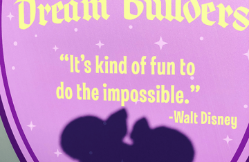"Mural at Disney World that reads ""It's fun to do the impossible. - Walt Disney."""