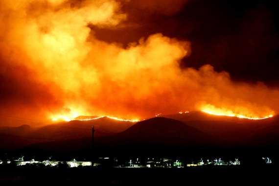 Wild fires rage along hills behind Los Angeles