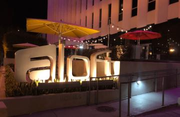aLoft Hotel monument, lit up at night.