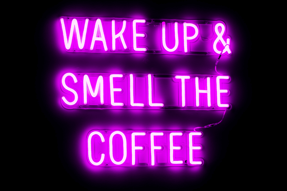 "Pink neon sign at coffee house that reads ""Wake Up & Smell the Coffee"""